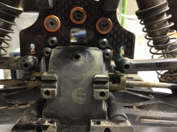 Extra link hole drilled below stock holes